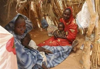 Internally displaced Sudanese women sit inside their make-shift house in their camp near El-Fasher, capital of the north Darfur region, Sudan March 25, 2007