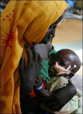 A mother tries to console her child at the Abu Shouk refugee camp near El Fasher in Darfur, Sudan, August 25, 2004
