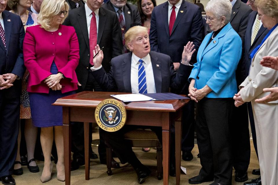 President Donald Trump signed bills in the  Roosevelt Room of the White House on Monday.