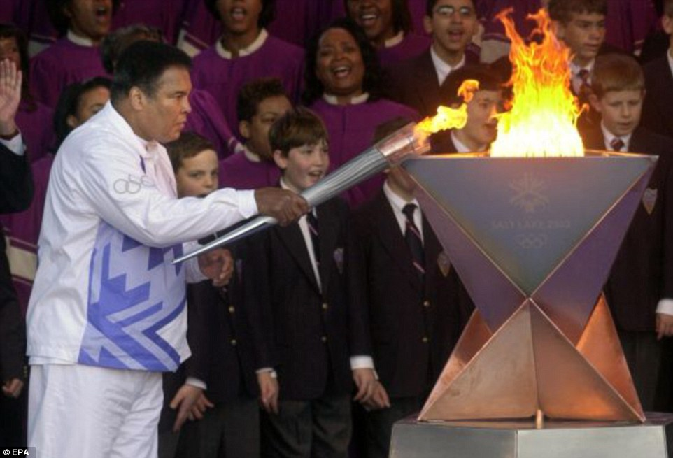 Ali, who won the gold medal in Rome in 1960, lights the Olympic flame ahead of the Games in Atlanta, Georgia in 1996